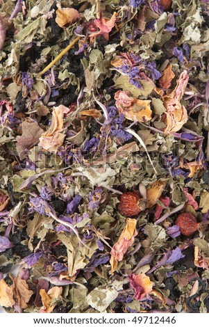 background of dried flowers, berries and tea leaves - stock photo