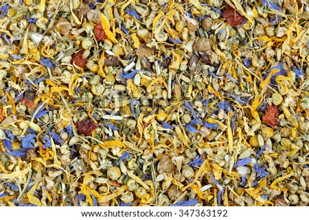 Background of dried flowers, berries and tea leaves. Mountain herb tea. - stock photo