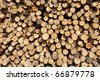 Background of dry chopped firewood - stock photo