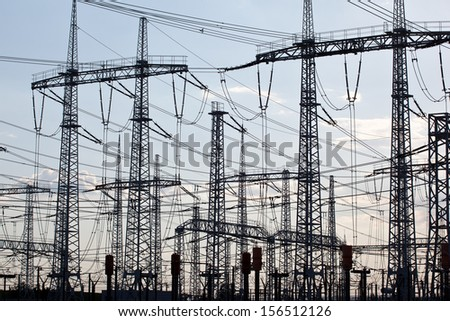Background of electricity distribution pylons - stock photo