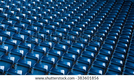 Background of empty blue stadium seats, grandstand
