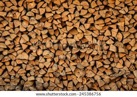 background of firewood stack - stock photo