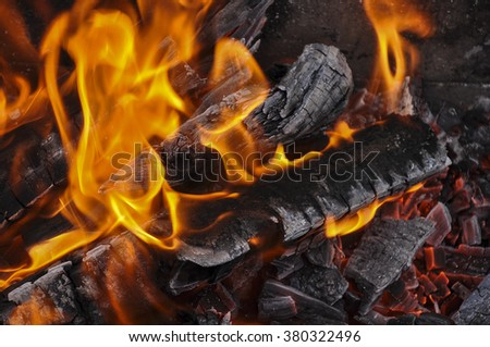 Background of Flames and Glowing Embers in a Campfire - stock photo