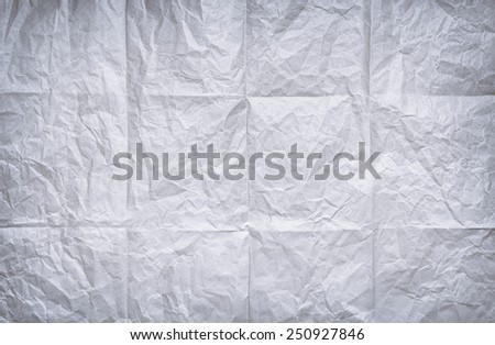 Background of folded and wrinkled old white paper sheet - stock photo