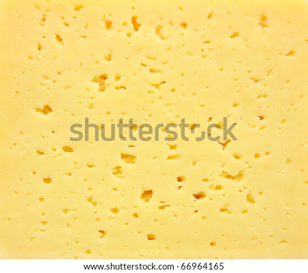 Background of fresh yellow Swiss cheese with holes - stock photo