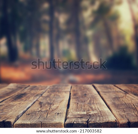 background of front rustic wood boards and forest background.  - stock photo