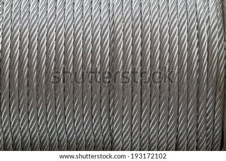 Background of galvanized metal cable on the winch - stock photo