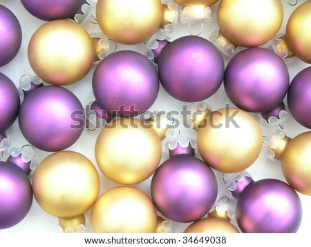 background of gold and purple Christmas tree ornaments - stock photo