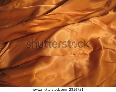 Background of golden silk - stock photo