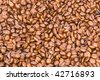 Background of gourmet freshly roasted coffee beans - stock photo