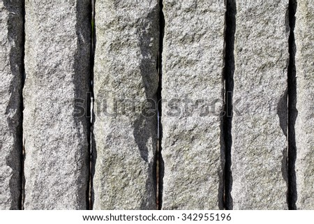 Background of granite stone wall texture, close up - stock photo