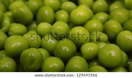 Background of green canned peas. - stock photo