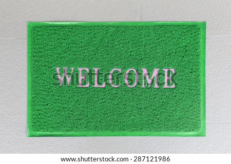 background of green welcome carpet - stock photo