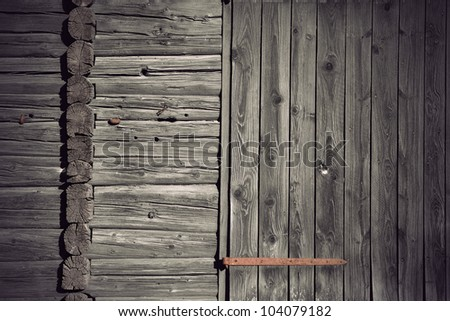 Background of grey wall of ancient weathered wood with rusty metal details - stock photo