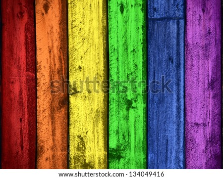 Background of grungy old wood planks in rainbow colors, gay pride symbol - stock photo