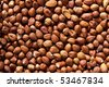 Background of hazelnuts: top view - stock photo