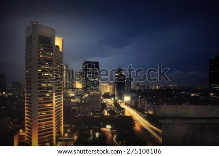 Background of jakarta city night scape with wall. You can put your object on the wall - stock photo