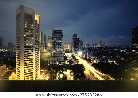 Background of jakarta city nightscape with wall. You can put your object on the wall - stock photo