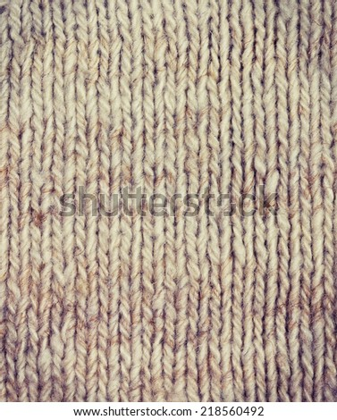 background of knitted fabric of wool yarn (vintage style) - stock photo