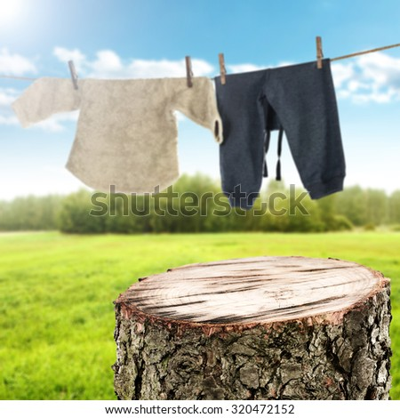 background of laundry on rope and baby clothes  - stock photo