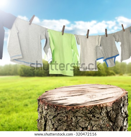 background of laundry on rope and gray clothes  - stock photo