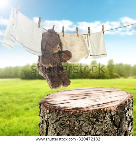 background of laundry on rope and wooden space  - stock photo