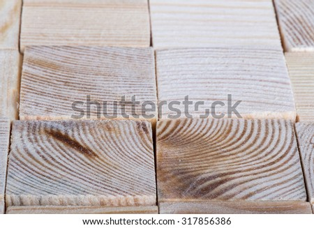 Background of light polished wooden cubes. Selective focus. Shallow depth of field. - stock photo