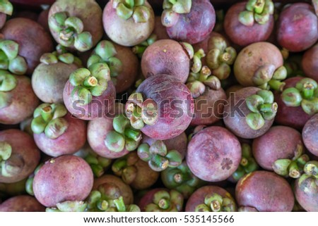 Background of mangosteen, focus on center.
