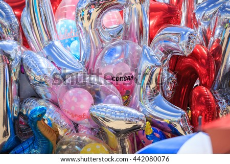 background  of many colorful balloons outdoors