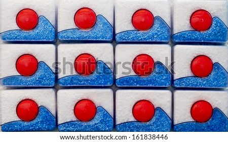 Background of many dishwasher tablets. - stock photo