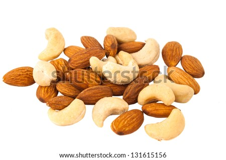 background of mixed nuts - hazelnuts, walnuts, almonds, pine nuts - stock photo