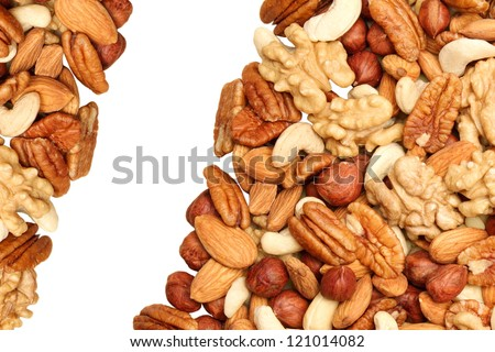background of mixed nuts - pecans, hazelnuts, walnuts, cashews, almonds, pine nuts, pistachios - stock photo