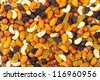background of mixture of nuts and raisins, closeup - stock photo