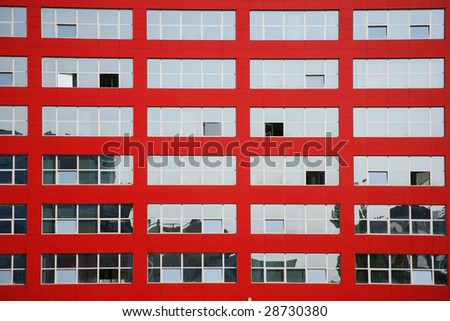 Background of multi glass windows on red building - stock photo