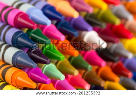 background of multicolored crayons organized in rows closeup - stock photo