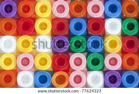 background of multicolored decorative plastic craft beads