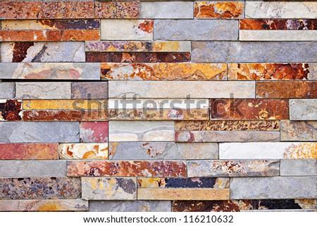 Background of natural slate stone veneer wall - stock photo