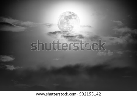 Background of nighttime sky with cloud and full moon with shiny. Natural beauty at night with moon behind cloud in black and white style. Vintage effect tone.