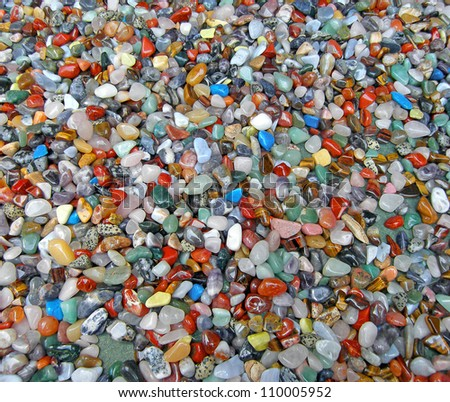 Background of numerous semi-precious stones - stock photo
