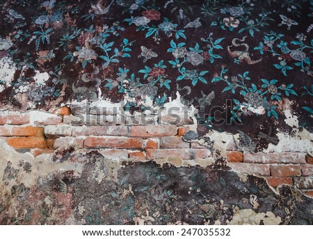 Background of old brick wall with cracked concrete area. - stock photo