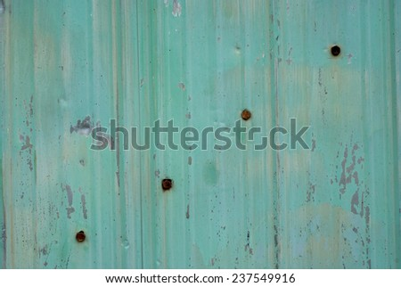 Background of old green painted metal sheets with rusty bolts - stock photo
