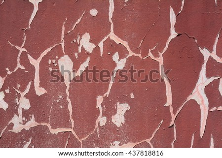 Background of old grungy maroon painted cracked wall texture - stock photo