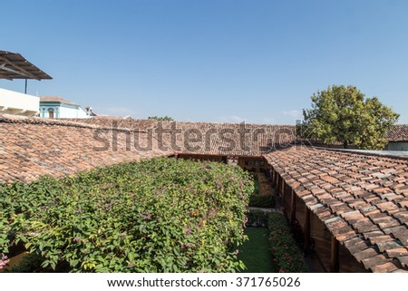 Background of old roof tiles from colonial House in Nicaragua - stock photo