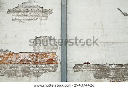 background of old vintage dirty brick wall with peeling plaster, texture - stock photo