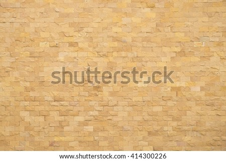 Background of old vintage orange brick wall, new paint old brick wall, old stone Cladding wall, strong brick wall for background texture - stock photo