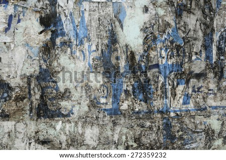 Background of old wall with poster residues.