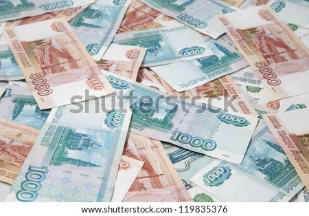 Background of one and five thousand russian roubles bills - stock photo