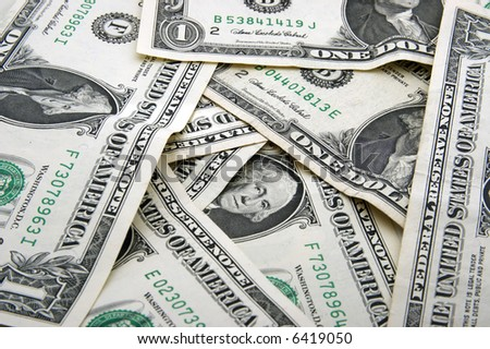 Background of One dollar bills in chaotic arrangement - stock photo