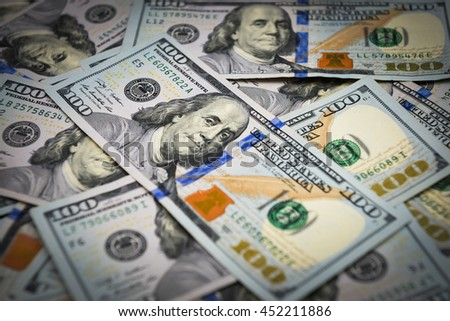 Background of one hundred dollar bills with vignette - stock photo