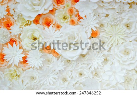 Background of paper-folding flower in orange and white color - stock photo